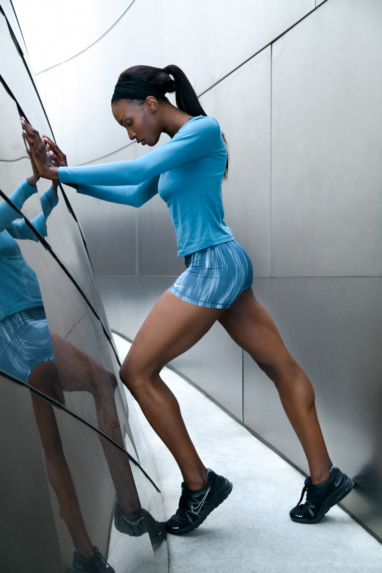 girl-stretches-on-cool-architecture-before-working-out