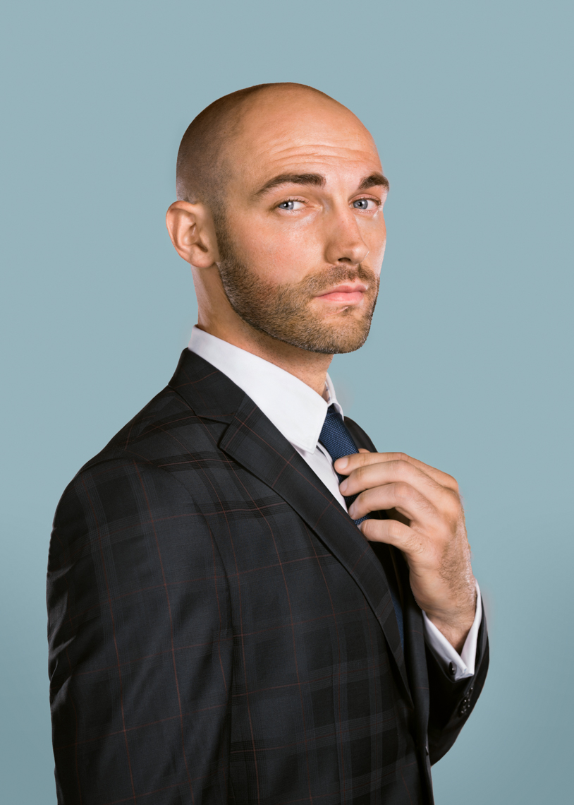 man-in-suit-adjusting-tie-studio-portrait-5x7